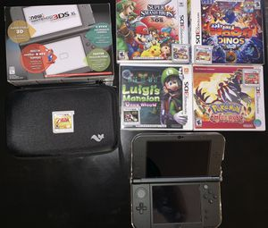 New nintendo 3DS XL with 5 games, cover and carrying case for Sale in Seattle, WA