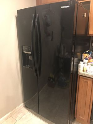 Samsung black refrigerator freezer combo side-by-side. Works perfect for Sale in Manteca, CA