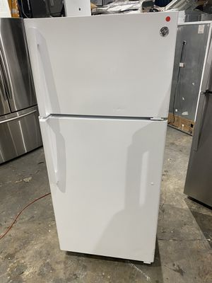 Ge refrigerator 28 x 59 almost new works perfect clean 60 days warranty for Sale in Salem, MA