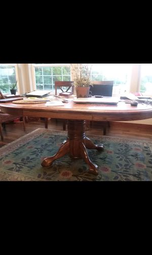 Very Nice Heavyduty adjustable Oak Table with 4 chairs. for Sale in Prosser, WA