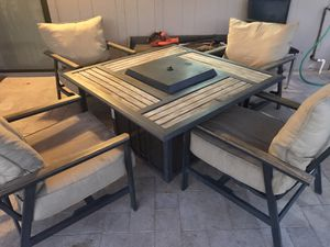 Patio furniture set fire pit table and chairs for Sale in Phoenix, AZ