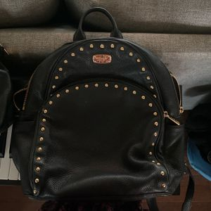 Michael Kors Black Leather Mini Backpack/ Purse With Gold Studded Front for Sale in Traverse City, MI