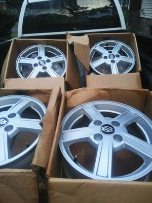 Off of my 2004 Suzuki berona.like new rims size 16x7.0 4x100/4.5+38 and two like new black wall tires size 205/55R16 for Sale in Detroit, MI