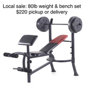 Brand new In box. Utility weight bench with rack , leg extension and preacher curl workout areas, also includes 80lbs of weight plates and a barbell for Sale in Puyallup, WA