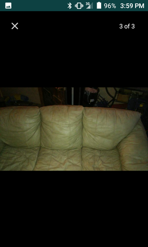 Tan leather reclining sofa and love seat for Sale in Cheney, KS