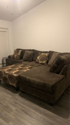 Full sized sofa and spinning chair for Sale in Alpharetta, GA
