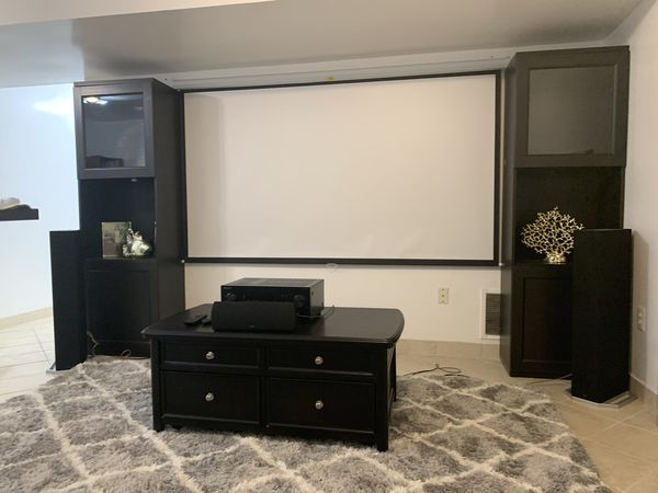 Coffee table , ikea towers, projector screen and projector