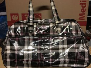 Used rolling luggage Roxy!! for Sale in Perris, CA