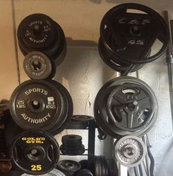 OLYMPIC 2 INCH PLATES & STANDARD 1 INCH PLATES ($2 A POUND) : OLYMPIC WEIGHTS : 45s. 25s. 5s. 2.5s STANDARD PLATES : 25s. 10s. 5s. 2.5s for Sale in Deerfield Beach,  FL