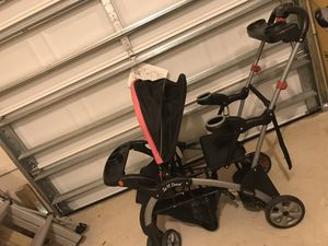 Pink and black sit&stand double stroller for Sale in Punta Gorda, FL