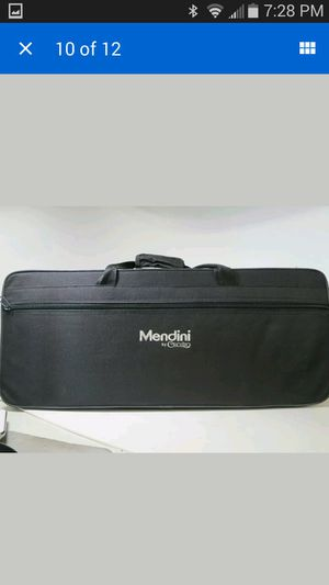 Brand new Mendini by Cecilio alto Brass Saxophone with tuner and case for Sale in Olney, MD