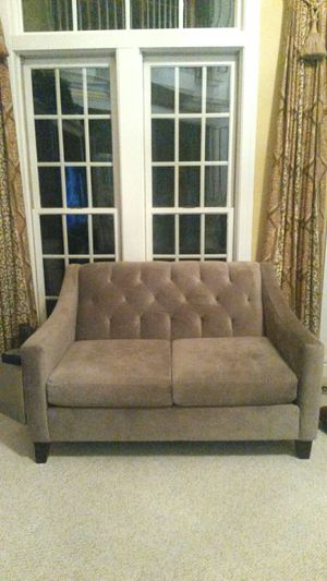 Gorgeous solid grey comfortable couch for Sale in Spencerville, MD