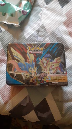 Pokemon tin lunch box packed with pokemon booster packs for Sale in Dover, NH