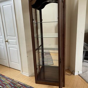 Pulaski 4 Shelf Cherrywood/Glass Display/Curio Cabinet with light for Sale in Lockport, IL