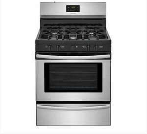 LIKE NEW matching Frigidaire five burner gas range and microwave. for Sale in Los Angeles, CA