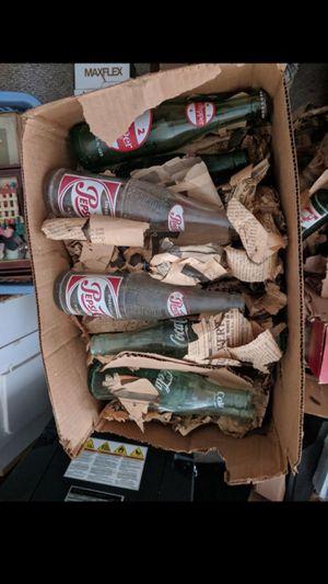 7 boxes looks like 200 antique coke, pepsi, 7-up etc. 40's,50's,60's,70's. for Sale in Arlington, VA