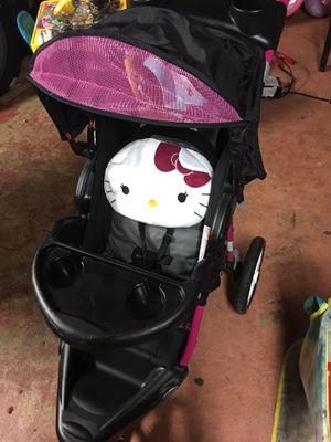 Good condition Hello Kitty jogger stroller and car seat set w/ base. for Sale in Acworth, GA
