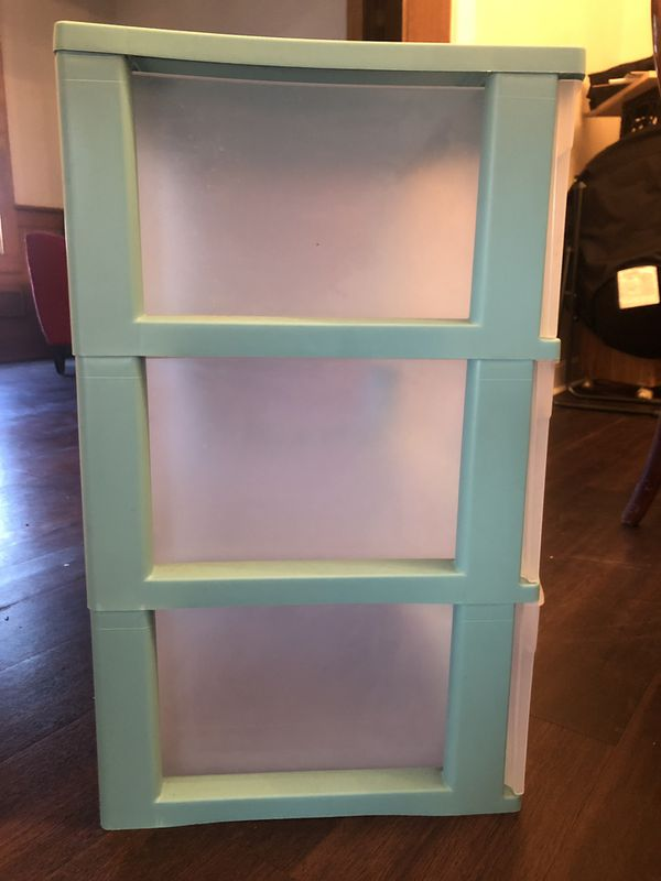 Light blue and clear, plastic three-tier drawers