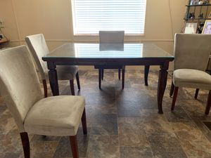 Large walnut Dinning room table With a leaf in the middle attached. Seats six with leaf in and seats eight with leaf out six micro suede chairs cream for Sale in Wenatchee, WA
