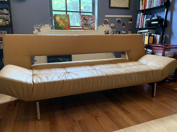 Designer leather futon / couch converts to bed