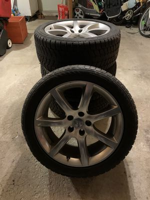(4) Bridgestone Blizzak LM-25V 245/45/18 Snow Tires with Infiniti rims for Sale in Downers Grove, IL
