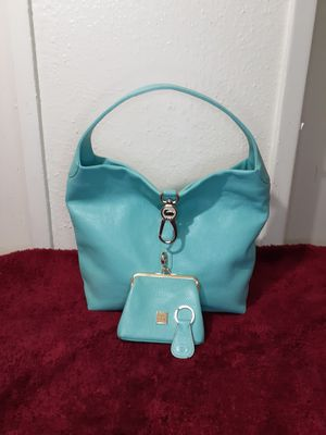 Dononey & Bourke Leather Logo Lock Hobo bag new leather in mint color ,logo reversible lock new,comes with special coin purse and key fob for Sale in Houston, TX