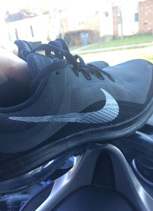 Nike tennis shoes gray and black for Sale in Manassas, VA
