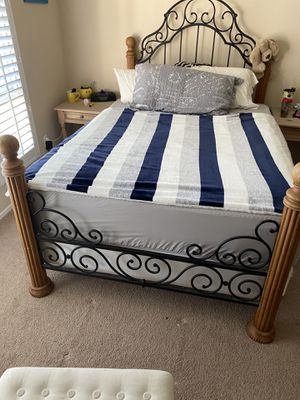 Hard wood and rot iron full sized head board and foot board for Sale in Mission Viejo, CA