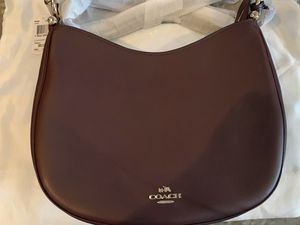 NEW w tags - COACH Nomad Crossbody bag - color Oxblood for Sale in Phoenix, AZ