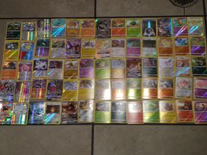 Must sell now!!! Over 500 mint condition pokemon cards with 72 holograms. 1 trainer tin. 1 trainer box and 15 online bonus cards for Sale in Las Vegas, NV