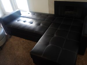 Leather couch futon with storages. for Sale in Las Vegas, NV