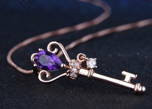 New Purple key Crystal pendant with chain rose gold color for Sale in San Francisco, CA