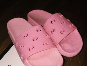 Gucci Women's rubber GG Slides for Sale in New York, NY