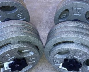 Weights(70lbs each dumbbell )12x10lb and 4x5lb plates with all steel dumbbell handles for Sale in Whittier,  CA