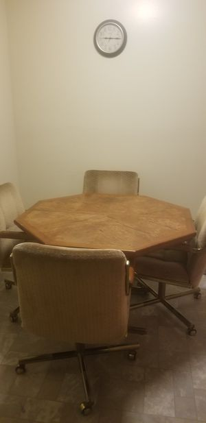 Wooden table with 4 rollable chairs for Sale in Pekin, IL