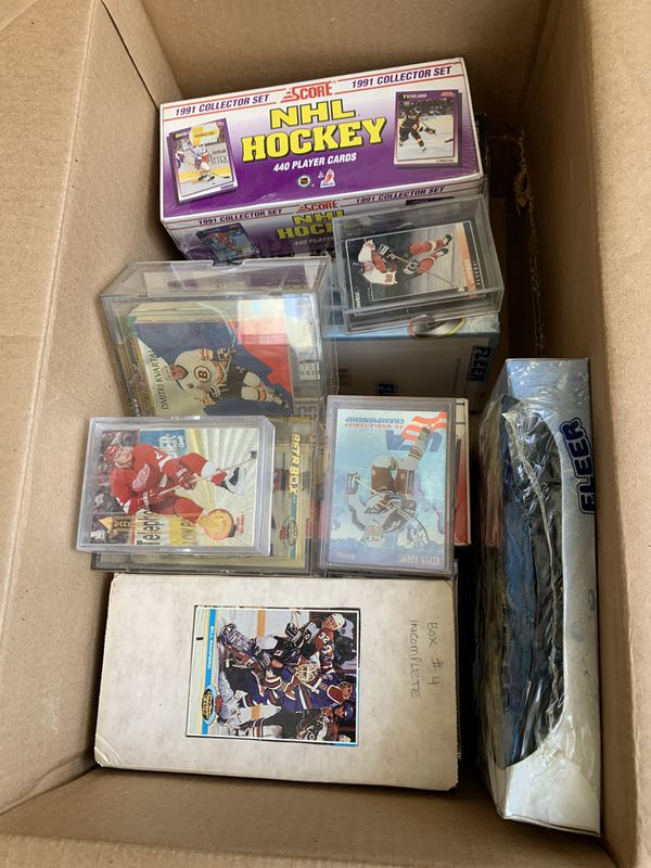Baseball, hockey and football cards. Mint condition. Many in unopened boxes.