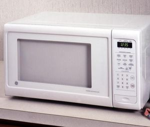 White GE Microwave for Sale in San Antonio, TX