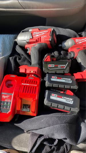 Milwaukee fuel 1/2 and 3/8 impact wrench and 3 batteries and rapid charger for Sale in Claremont, CA