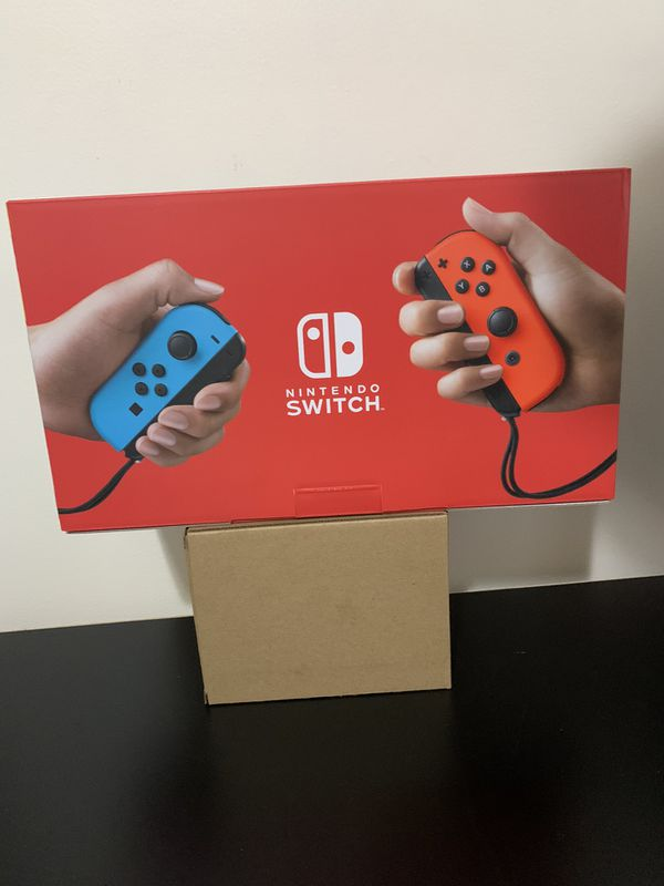 Nintendo Switch with Neon Blue and Neon Red Joy‑Con (Newest Model)