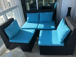 Rattan patio chair set (2 chairs and one sofa) with blue cushions for Sale in North Miami, FL
