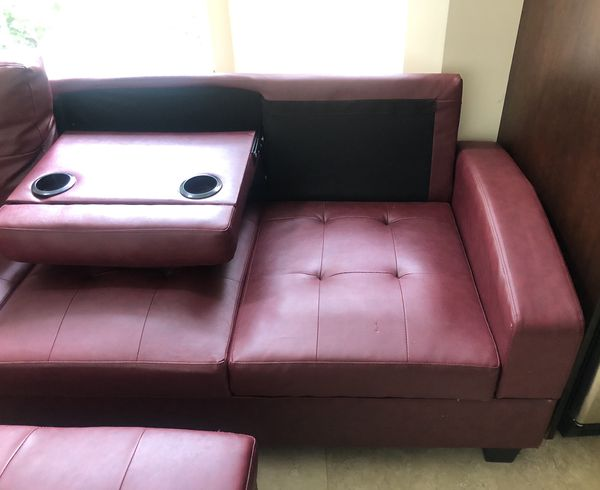 Maroon 2 piece couch with ottoman
