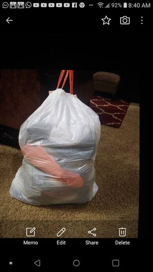 Full trash bag Mens clothes size 36 shorts, pants and L and xl shirts and shorts some new for Sale in Bakersfield, CA