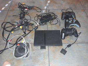 A collection of ps2 and Atari joy stick and controllers and pst game 20 doll for it all for Sale in Las Vegas, NV