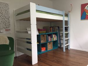 Wood Bunk Bed with a ladder and a fall out protection for Sale in Seattle, WA