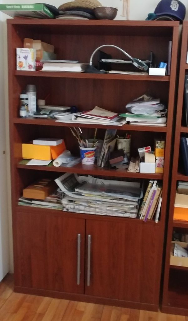 Ikea Walnut finish bookcase with doors