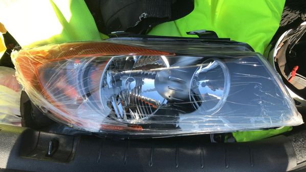 Headlight, passenger side 2006-2008 BMW