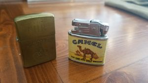 ---> Qty. 2 ~Camel Vintage Cigarette Lighters <-- The One And Only Smoke, Camel Logo 1995  & Camel Tuxedo Joe Brushed Brass Zippo lighter 1991 for Sale in Lutz, FL