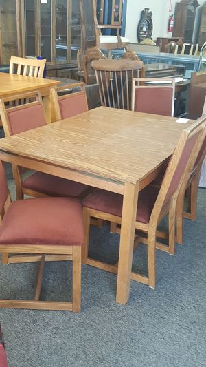 Liberty Furniture Company solid oak formica table with leaf and 6 chairs for Sale in Elyria, OH
