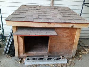 Huge great condition extra large dog house with floor tile very sturdy and heavy and the top comes up for Sale in El Monte, CA
