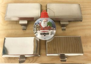 Holidays/Christmas Decorations: (4) Stocking Holders - two silver, two brush nickel w/ bonus Santa musical ornament! for Sale in Pembroke Pines, FL